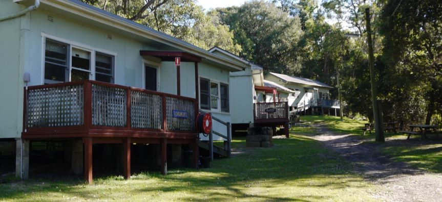 Cabins lining the bush track