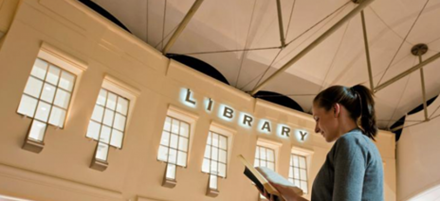 Woman reading a book outside the Warringah Mall library