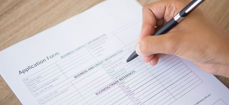 Person completing a job application form