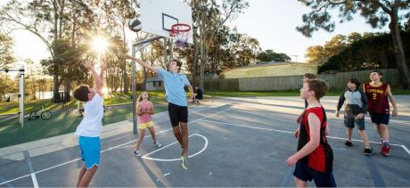 Youth playing basketball